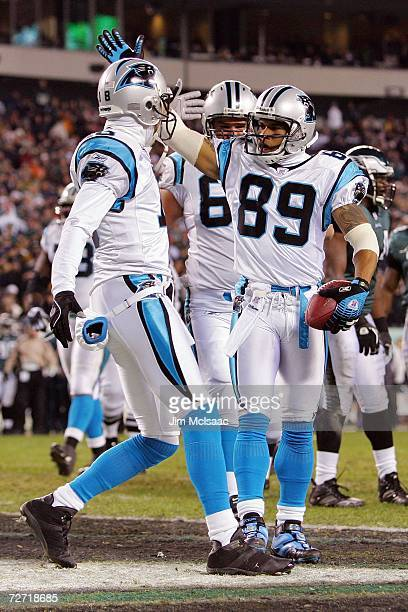 Steve Smith of the Carolina Panthers celebrates his touchdown catch with Drew Carter in the first quarter against the Philadelphia Eagles at Lincoln...