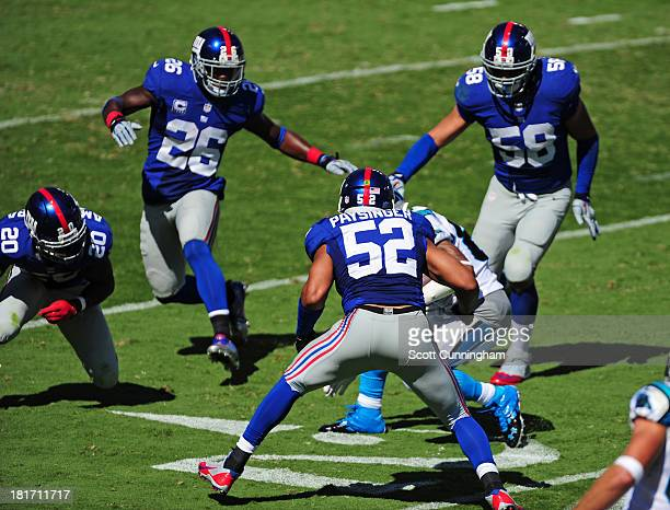 Steve Smith of the Carolina Panthers is surrounded by Spencer Paysinger Prince Aumkamara Antrel Rolle and Mark Herzlich of the New York Giants at...