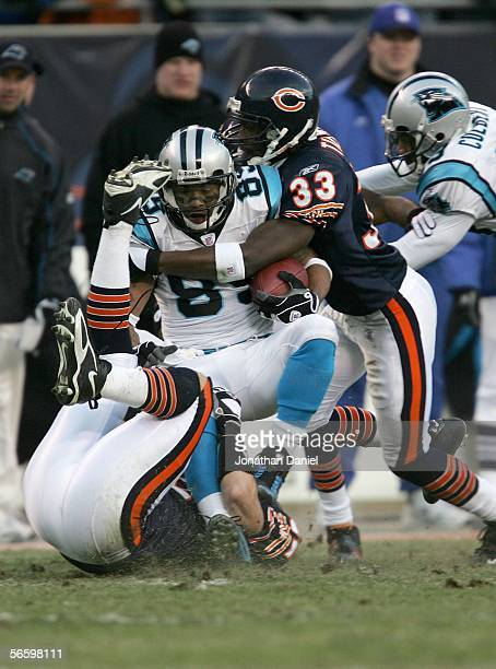 Steve Smith of the Carolina Panthers is tackled by Charles Tillman and Hunter Hillenmeyer of the Chicago Bears in the NFC Divisional playoff game at...
