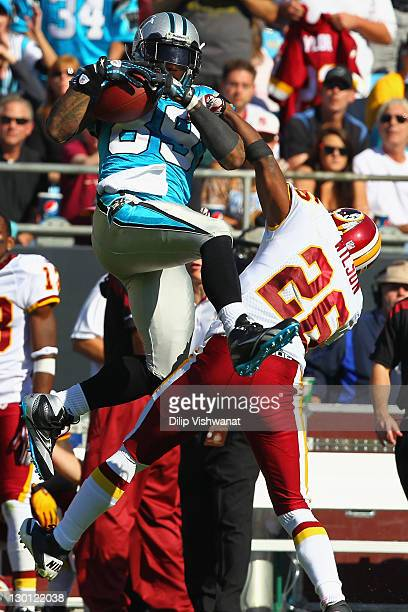 Steve Smith of the Carolina Panthers makes a catch against Josh Wilson of the Washington Redskins at the Bank of America Stadium on October 23, 2011...