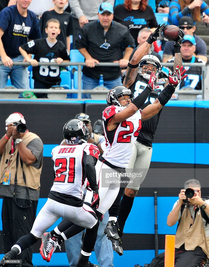Steve Smith #89 of the Carolina Panthers makes a catch in the end zone over defender Chris Hope #24 of the Atlanta Falcons but is ruled out-of-bounds during play at Bank of America Stadium on December 9, 2012 in Charlotte, North Carolina.