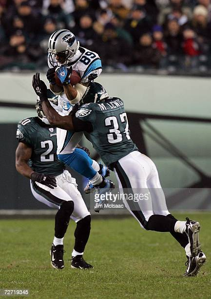 Steve Smith of the Carolina Panthers makes a catch over Brian Dawkins#20 and Michael Lewis of the Philadelphia Eagles late in the second quarter at...