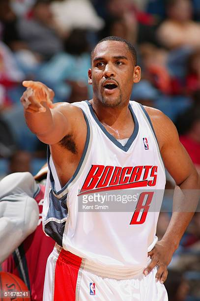 Steve Smith of the Charlotte Bobcats points during the preseason game against the Atlanta Hawks at Crown Coliseum on October 27, 2004 in...