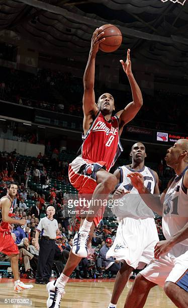 Steve Smith of the Charlotte Bobcats shoots over Michael Ruffin the Washington Wizards during the game on November 4 2004 at the Charlotte Coliseum...