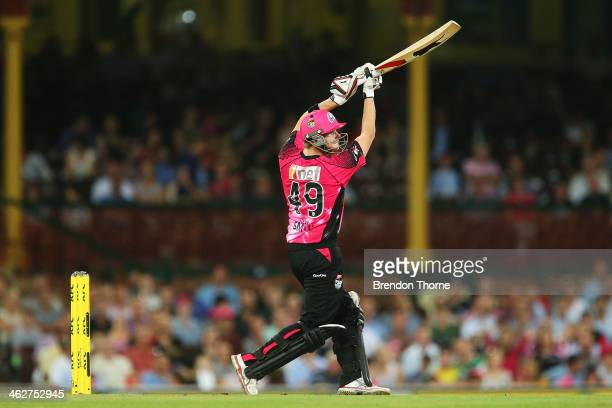 Steve Smith of the Sixers hits for six during the Big Bash League match between the Sydney Sixers and the Hobart Hurricanes at SCG on January 15 2014...