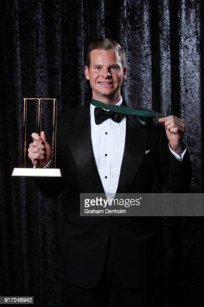 Steve Smith poses with the Allan Border Medal and the award for Test Player of the Year during the 2018 Allan Border Medal at Crown Palladium on...