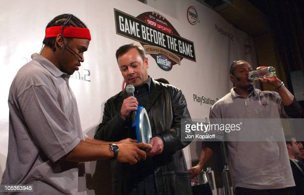 Steve Smith receives his trophy from Jack Tretton Senior Vice President of Sony Computer Entertainment America after winning the 989 Sports Game...