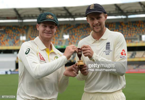 Steve Smith the Australian captain and Joe Root the England captain with a replica of the Ashes urn before the first Ashes cricket test match...