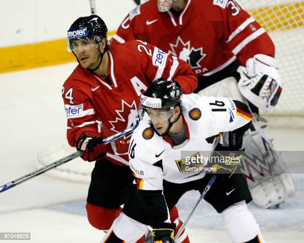 Steve Staios of Canada defends against Michael Wolf of Germany during the IIHF World Ice Hockey Championship qualification round at the Halifax Metro...