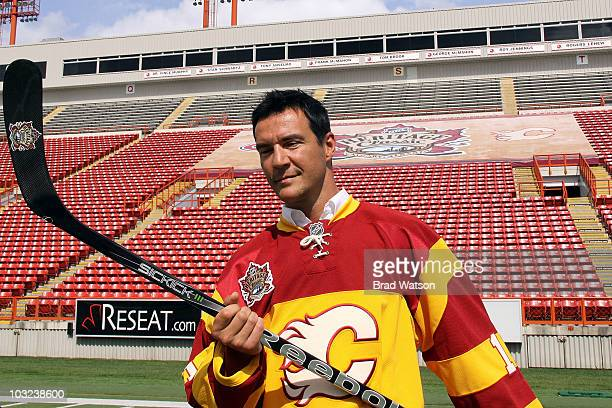 Steve Staios of the Calgary Flames shows off his jersey for the 2011 NHL Heritage Classic against the Montreal Canadiens at a press conference on...