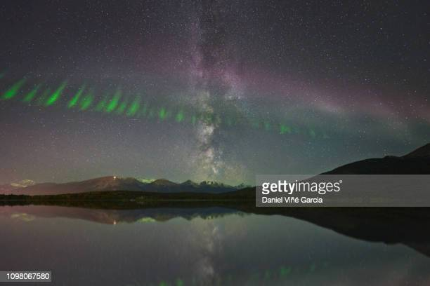 steve (steve (atmospheric phenomenon), northern lights and milky way over the patricia lake in jasper national park, alberta, canada. - light natural phenomenon stock photos and pictures