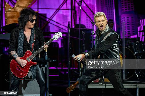 Steve Stevens and Billy Idol perform at DTE Energy Music Theater on August 07, 2019 in Clarkston, Michigan.