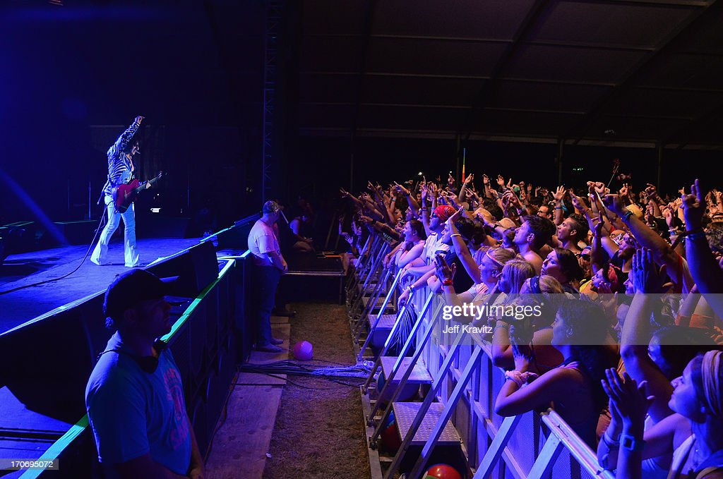 Steve Stevens performs with Billy Idol at That Tent during day 3 of the 2013 Bonnaroo Music & Arts Festival on June 15, 2013 in Manchester, Tennessee.