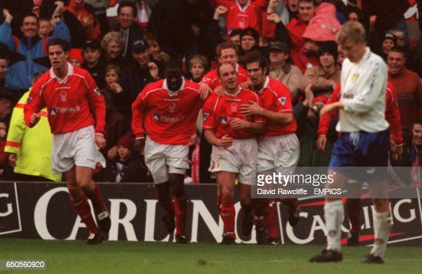 Steve Stone of Nottingham Forest celebrates with teammates Andy Johnson Chris BartWilliams and Andy Gray
