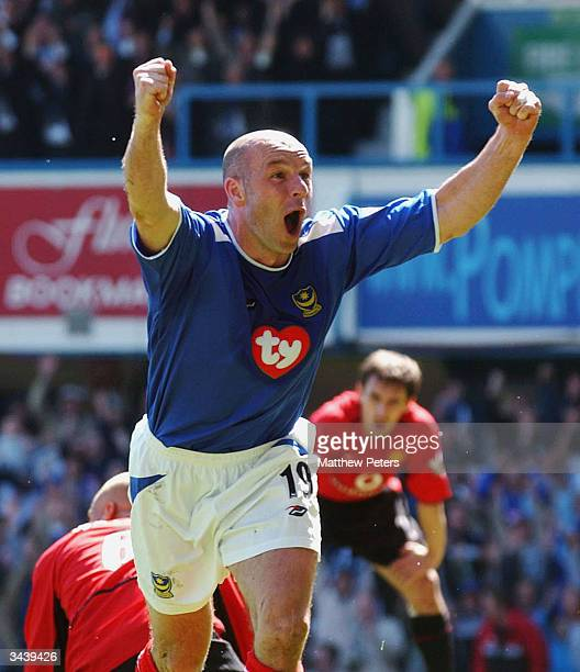 Steve Stone of Portsmouth celebrates scoring their first goal during the FA Barclaycard Premiership match between Portsmouth and Manchester United at...