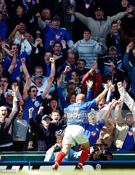 Steve Stone of Portsmouth celebrates scoring their first goal in front of the home fans during the FA Barclaycard Premiership match between...
