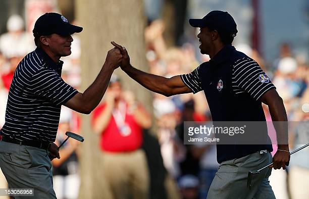 Steve Stricker and Tiger Woods of the USA celebrate Wood's birdie on the 13th green during day two of the Afternoon FourBall Matches for The 39th...