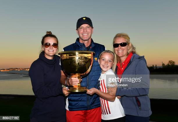Steve Stricker Captain of the US Team his wife Nicki and daughters Bobbi Maria and Isabella pose with the trophy after the US Team defeated the...