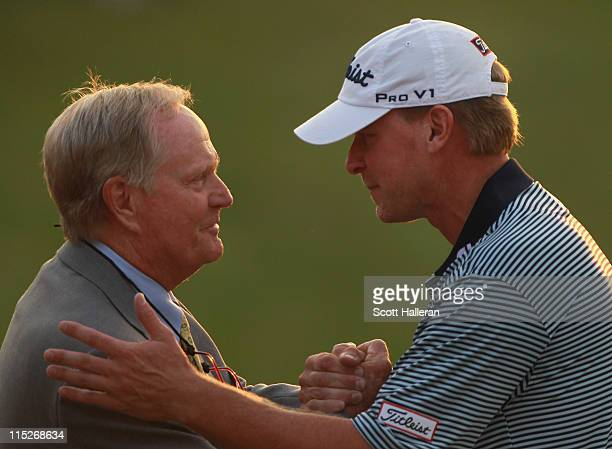 Steve Stricker celebrates with tournament host Jack Nicklaus near the 18th green after winning the Memorial Tournament presented by Nationwide...