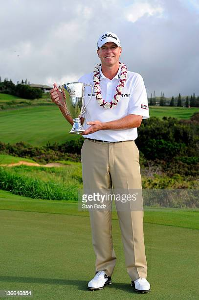 Steve Stricker holds the champions trophy after winning the final round of the Hyundai Tournament of Champions at Plantation Course at Kapalua on...