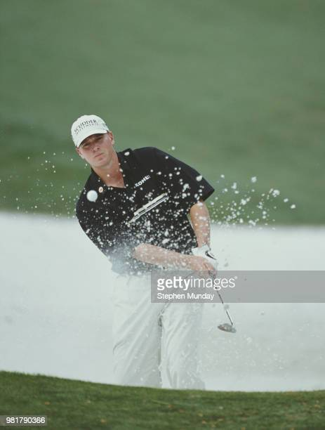Steve Stricker of the United States keeps his eye on the ball as he chips out of the sand bunker on 5 April 2001 during the US Masters Golf...