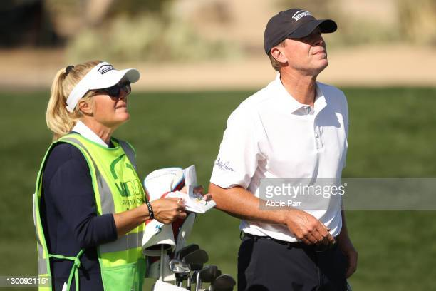 Steve Stricker of the United States looks on with his caddie and wife Nicki Stricker on the 14th hole during the final round of the Waste Management...