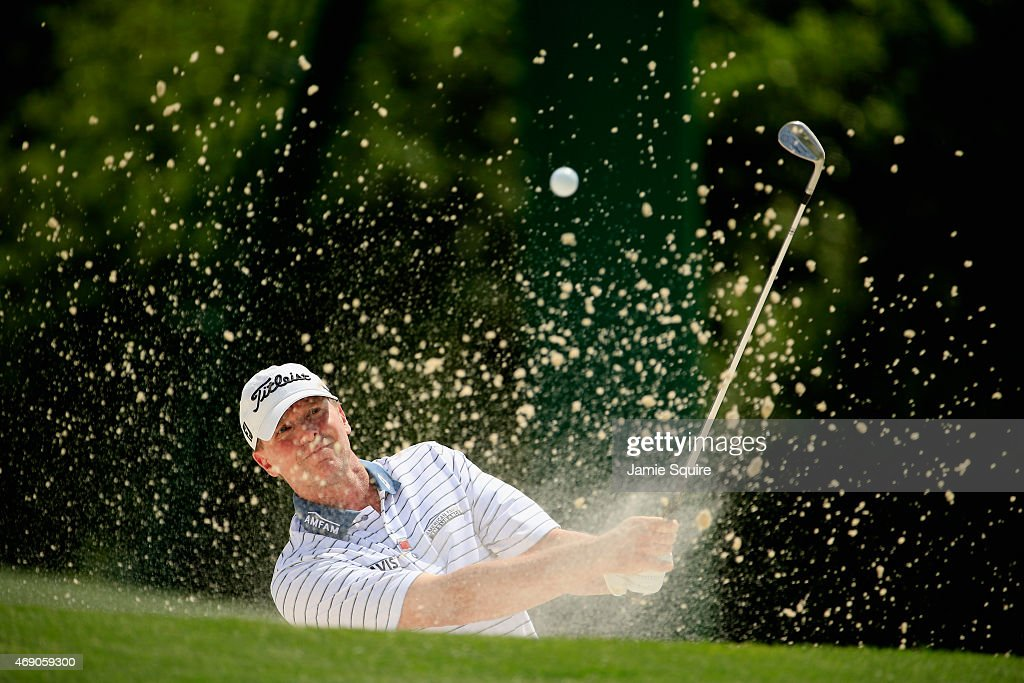 Steve Stricker of the United States plays a bunker shot on the 18th hole during the first round of the 2015 Masters Tournament at Augusta National Golf Club on April 9, 2015 in Augusta, Georgia.
