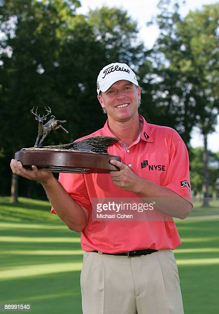 Steve Stricker of the USA holds the trophy after winning the John Deere Classic at TPC Deere Run held on July 12 2009 in Silvis Illinois