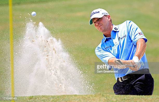 Steve Stricker plays a bunker shot on the first hole during the third round of the 93rd PGA Championship at the Atlanta Athletic Club on August 13,...