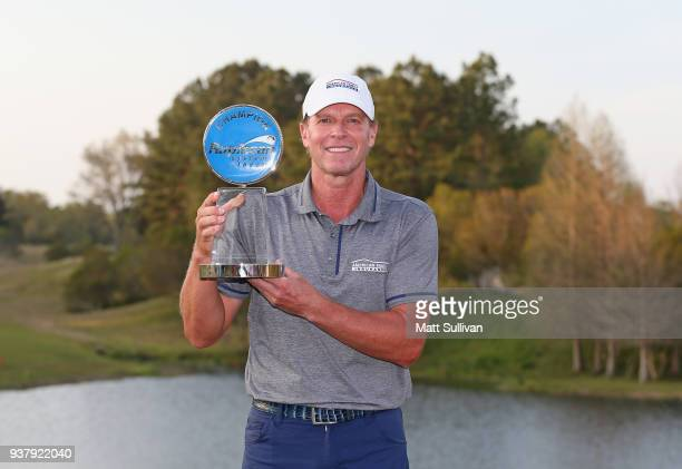 Steve Stricker poses with the Anthony J Topazi trophy after winning the final round of the Rapiscan Systems Classic at Fallen Oak Golf Course on...