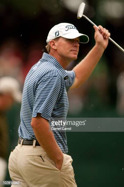Steve Stricker raises his putter to acknowledge the gallery at the 18th hole during the final round of the John Deere Classic at TPC Deere Run on...