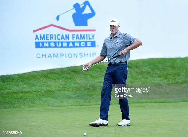 Steve Stricker reacts after missing a putt that would have won the tournament on the 18th green during the final round of the American Family...