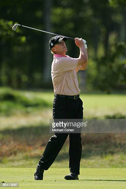 Steve Stricker watches his second shot on the 15th hole during the third round of the Deutsche Bank Championship at TPC Boston held on September 6,...