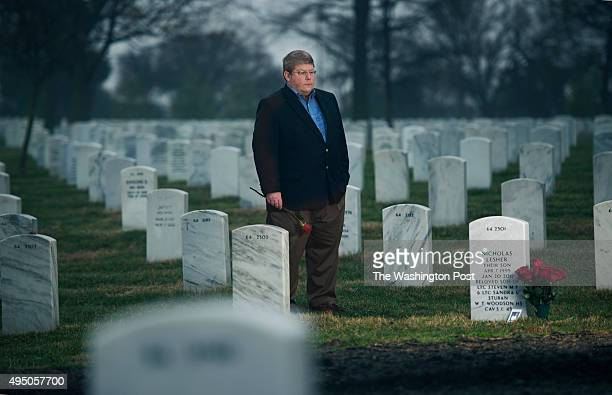 Steve Stuban at the grave of his son Nick, a Woodson High School student who took his own life in Arlington, VA on March 29, 2014. In 2011 Nick was a...