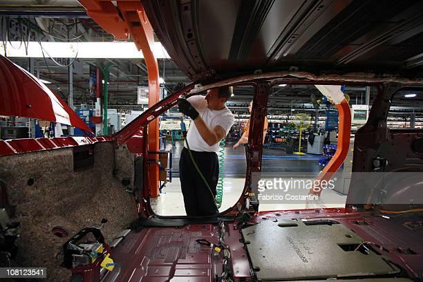 Steve Swancott installs trim for a Chrysler Minivan on the assembly line at the Chrysler Windsor Assembly plant January 18 2011 in Windsor Ontario...