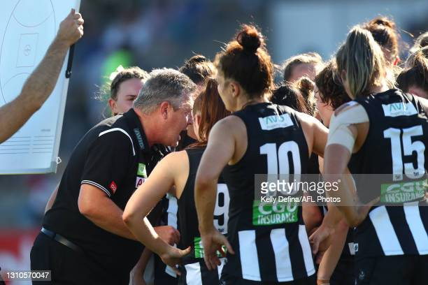 Steve Symonds coach of the Magpies speaks to players during the AFLW Finals Series match between the Collingwood Magpies and the North Melbourne...