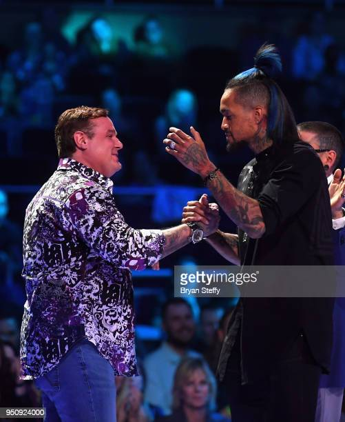 Steve Tefft and Anthony Michaels stand onstage during the Ink Master Season 10 Finale at the Park Theater at Monte Carlo Resort and Casino in Las...