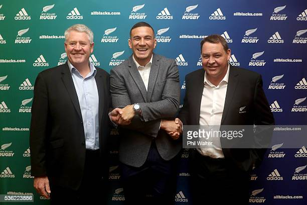 NZRU CEO Steve Tew Sonny Bill Williams and All Black coach Steve Hansen shake hands following a press conference at the Heritage Hotel on June 1 2016...