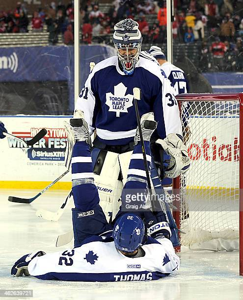 Steve Thomas entertains Curtis Joseph of the Toronto Maple Leafs Alumni prior to the game against the Detroit Red Wings Alumni on December 31 2013 at...