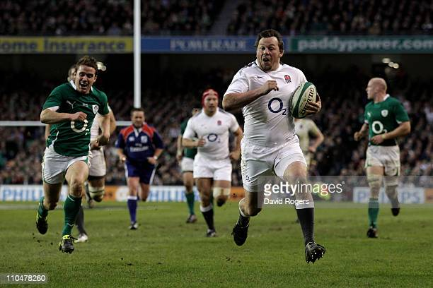 Steve Thompson of England races away to score a try despite the best efforts from Eoin Reddan of Ireland during the RBS 6 Nations Championship match...