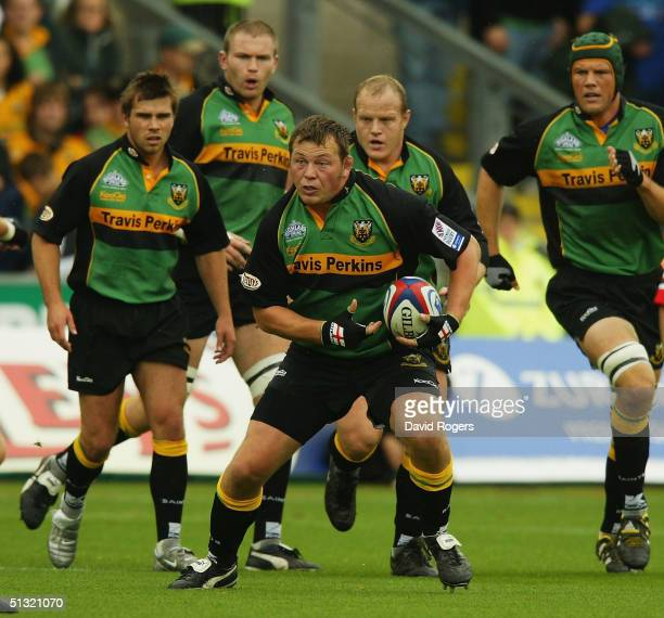 Steve Thompson, the Northampton hooker charges forward with the ball during the Zurich Premiership match between Northampton Saints and Gloucester at...
