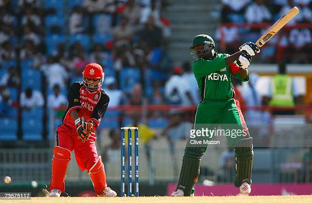 Steve Tikolo of Kenya hits out watched by Ashish Bagai of Canada during the ICC Cricket World Cup Group C match between Canada and Kenya at the...