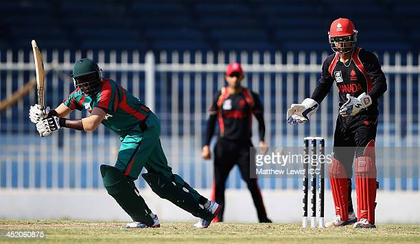Steve Tikolo of Kenya hits the ball towards the boundary as Ashish Bagai of Canada looks on during the ICC World Twenty20 Qualifier 11th Place...