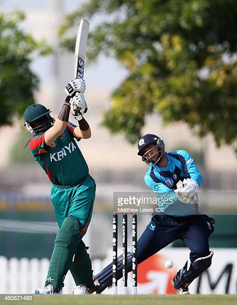 Steve Tikolo of Kenya hits the ball towards the boundary as David Murphy of Scotland looks on during the ICC World Twenty20 Qualifier match between...