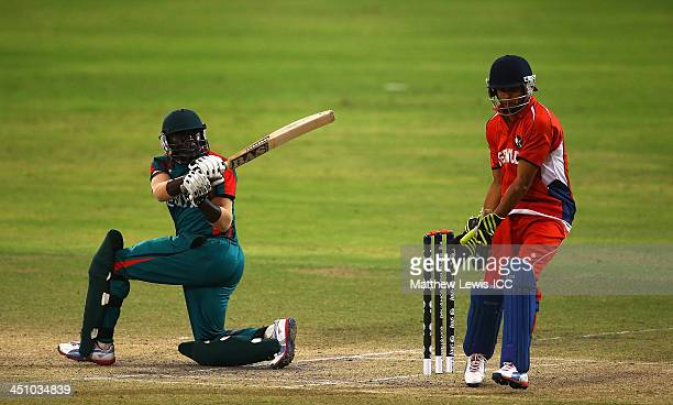 Steve Tikolo of Kenya hits the ball towards the boundary as Christopher Douglas of Bermuda looks on during the ICC World Twenty20 Qualifier match...