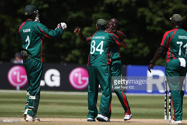Steve Tikolo of Kenya is congratulated by Hiren Varaiya after getting a wicket during an ICC World Cup qualifying match against Uganda on January 19...
