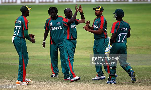 Steve Tikolo of Kenya is congratulated by team mates after bowling Janeiro Tucker of Bermuda during the ICC World Twenty20 Qualifier match between...
