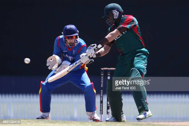 Steve Tikolo of Kenya plays a shot in front of wicketkeeper JP Kotze during an ICC World Cup qualifying match between Namibia and Kenya on January 17...
