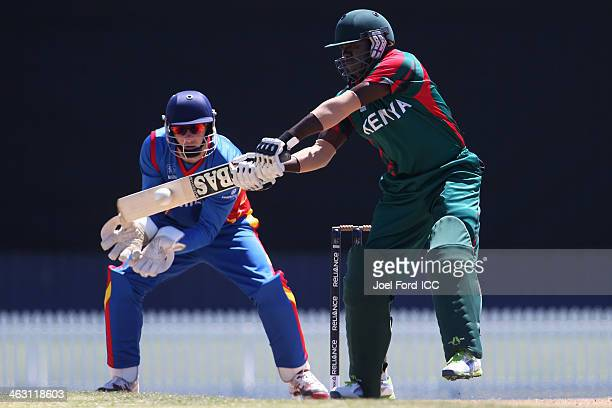 Steve Tikolo of Kenya plays a shot in front of wicketkeeper JP Kotze of Namibia during an ICC World Cup qualifying match between Namibia and Kenya on...