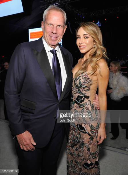Steve Tisch and Katia Francesconi attend the 26th annual Elton John AIDS Foundation Academy Awards Viewing Party at The City of West Hollywood Park...